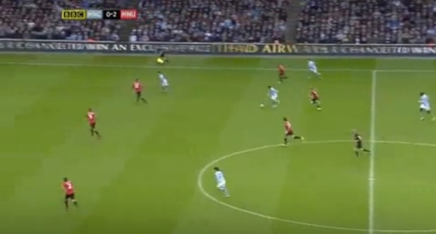 In the build-up to City's first, Tevez collects the ball between United's defence and midfield and breaks forward into space.
